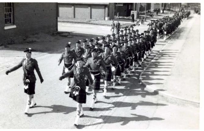 Dad is front right (ie; in charge!) casting the longest shadow. The H.L.I. marching through Maryhill in the late 40s.
