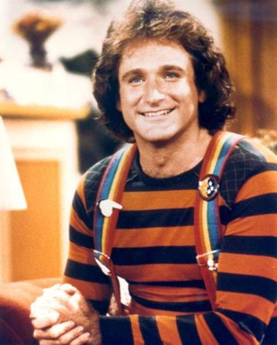 Robin Williams as Mork