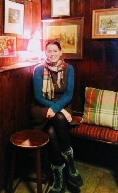 burns - keara in the snug at the globe inn - on bench with tartan cushion