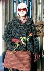 burns - keara leaving a rose at robert burns grave in dumfries